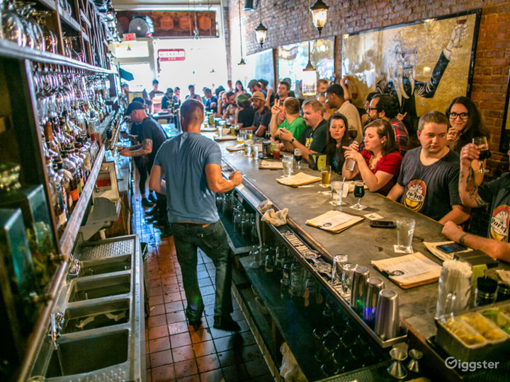 Spacious Beer Bar with Wood and Brick Features Photo 3