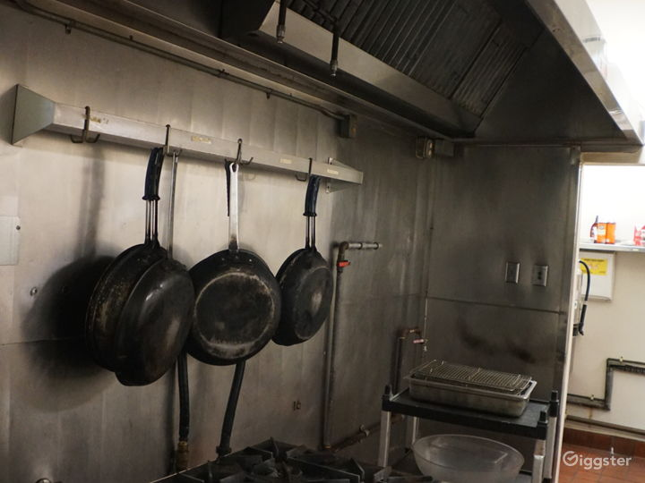 commercial kitchen with hood, walk-ins, etc