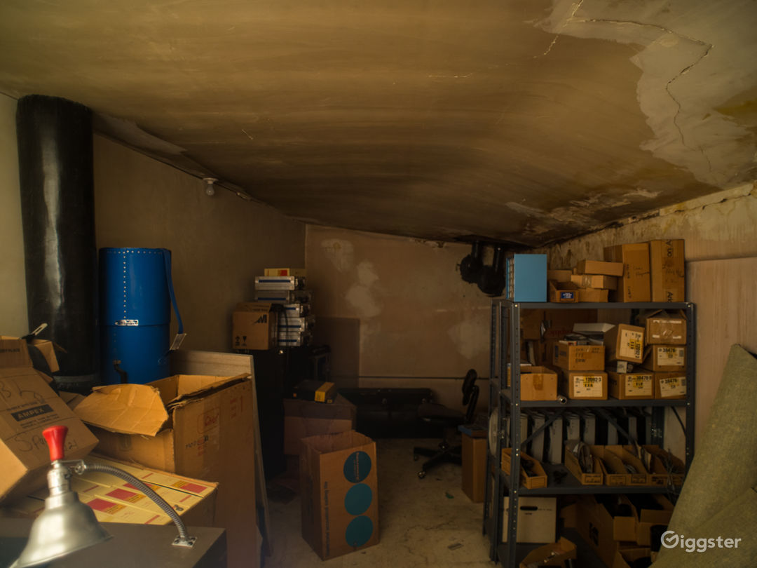A grungy room inside the stock room