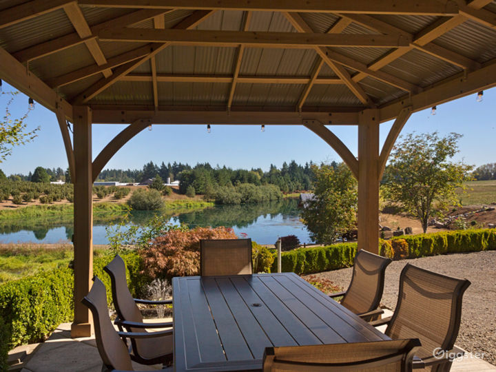 Tranquil beauty awaits under the gazebo next to a tranquil goldfish pond overlooking the large pond, pier and dock.