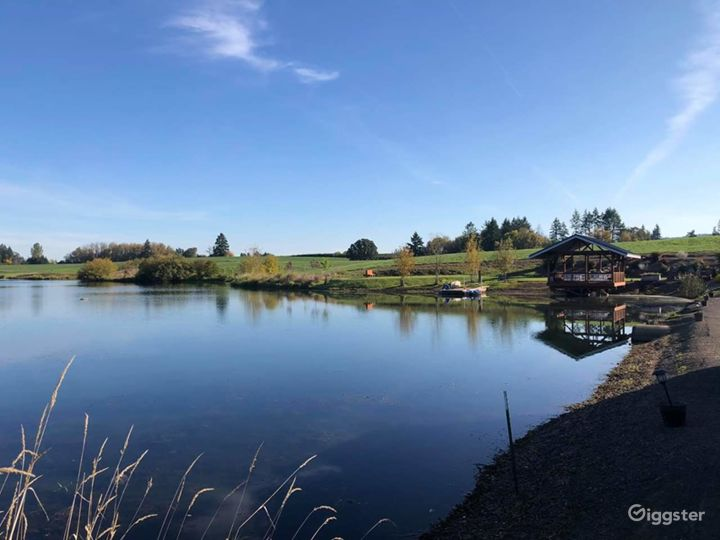 Pondview overlooks a 7 acre pond, pier, farmland, orchards, forests and hills.  A unique, private location!