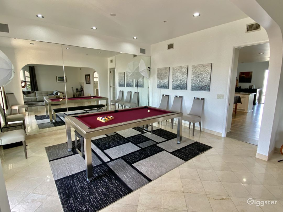Dining room with table that converts into pool table