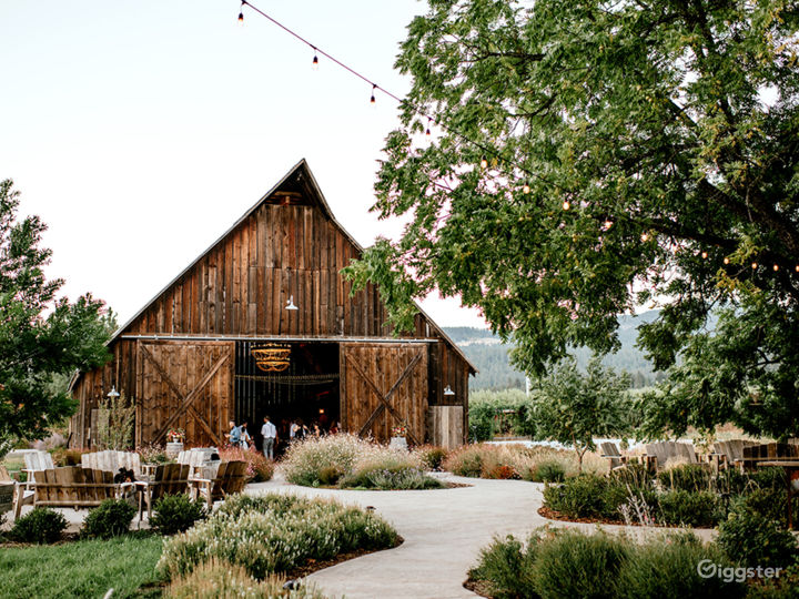 Barn and courtyard (fire pit to left, additional seating area to right under tree)