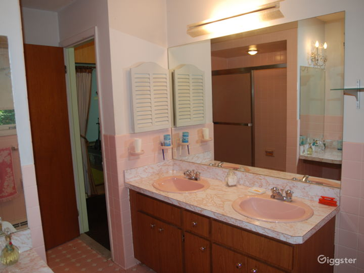 Jack & Jill pink tiled bathroom