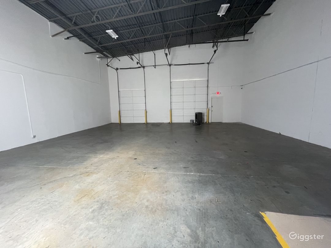 raw warehouse space with roll up doors for easy loading and unloading