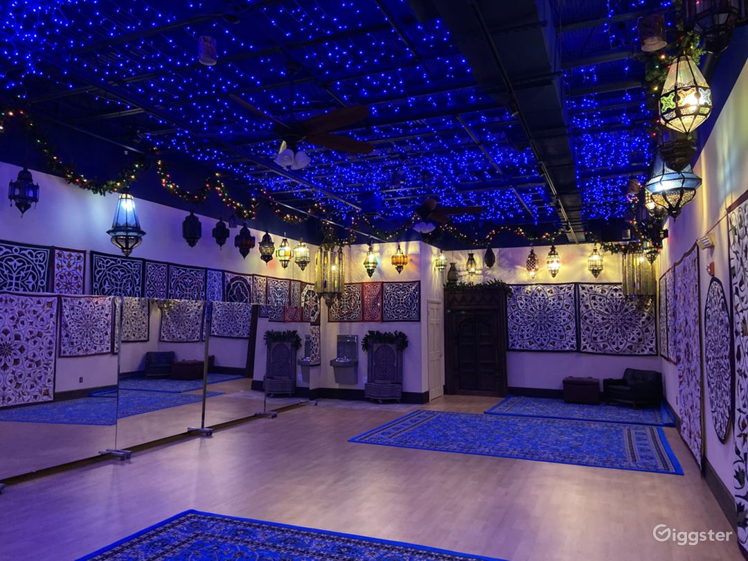 Blue ambient ceiling lighting on a separate switch. Mirrors are on rollers and can be removed. Tapestries can be removed. Turquoise and black rugs to cover the dance floor can be laid down or removed. Studio is 1000 sq ft.