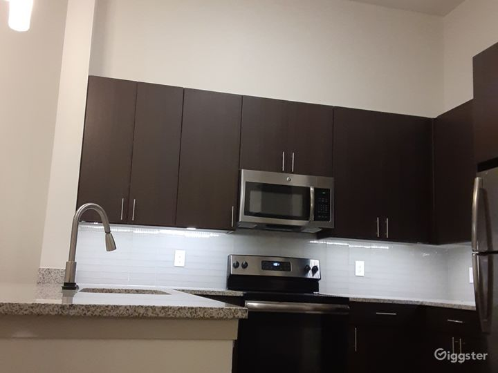 This is another view of the kitchen at a different angle', with a lot of cooking space' as you can see...