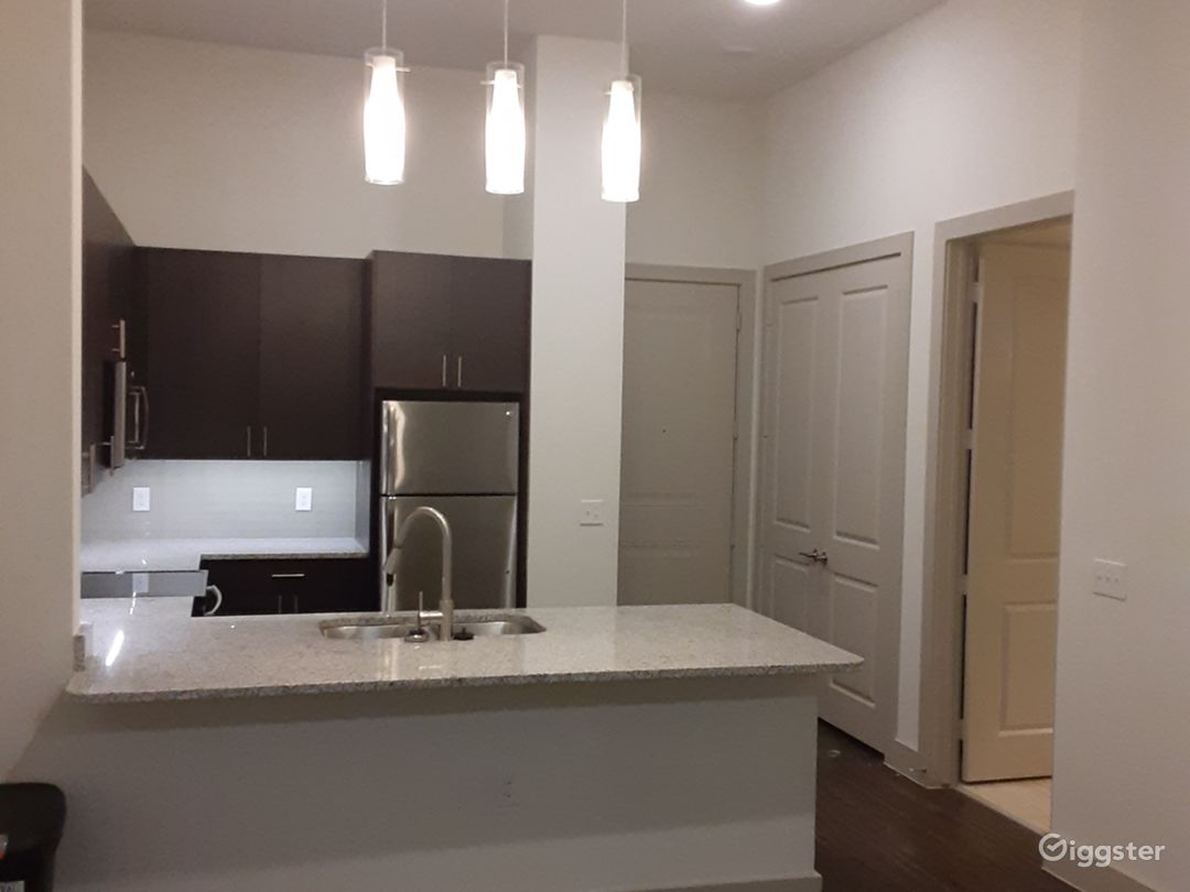 This is the entrance from the living room at the kitchen, the granite is beautiful isn't it...  GE Washer & Dryer are in the double door laundry room.