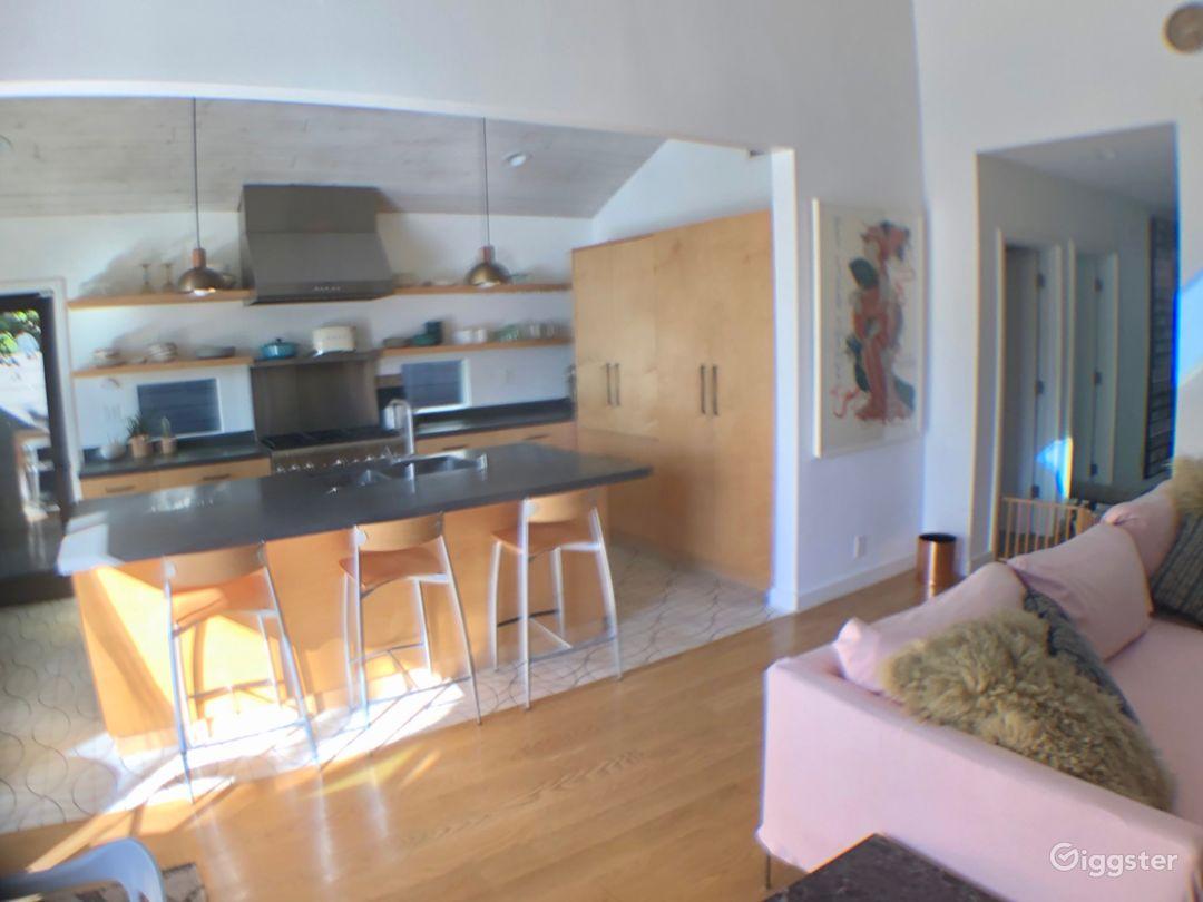 Open kitchen, tile floors, wood cabinets, granite countertops, stainless steel appliances.