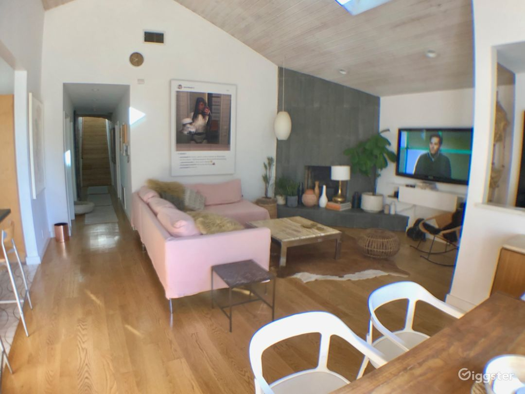 Living room, hallway leads to bathroom and makeup/prep room. Sofa can be pink or all white.