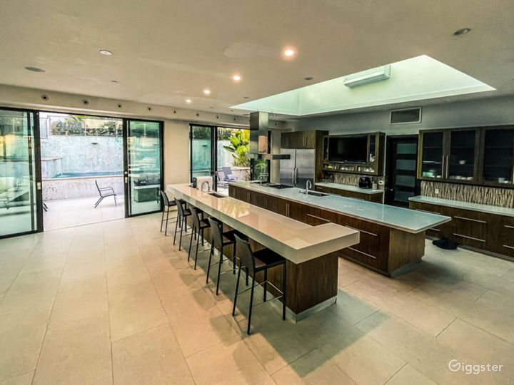 Chef's Kitchen with mutiple ovens, large hob space, worktops and spacious food storage [Fridge and Freezer]