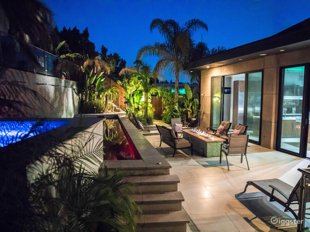 Spacious backyard with Pool, Jacuzzi and Iconic Hollywood sign back tiling. Well mainted greenery and coloured lighting.