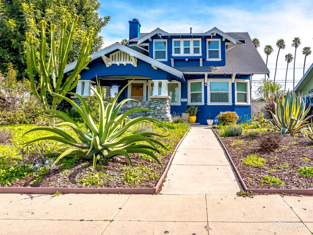Large front porch; front yard features gorgeous succulent plants