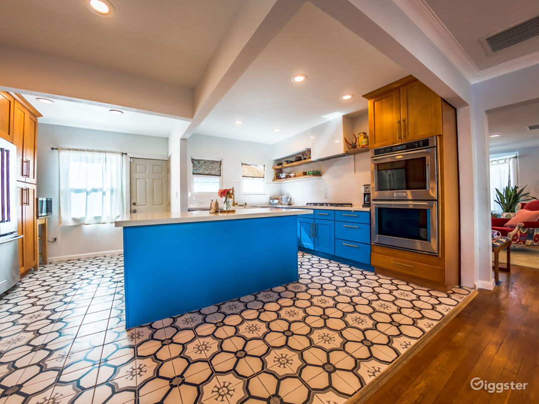 Kitchen is open and features a double oven.