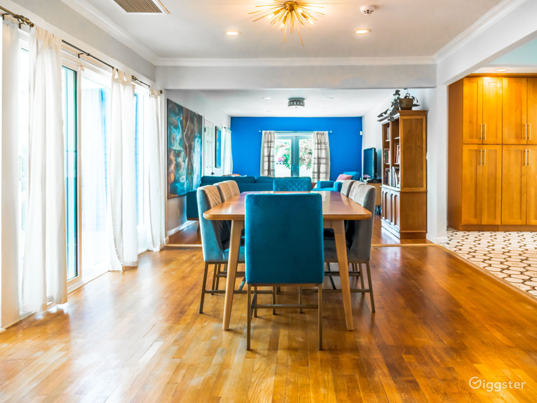 Large dining room area with french doors leading to an additional room