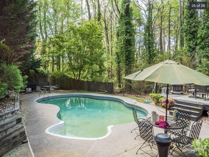View of pool and lush backyard.