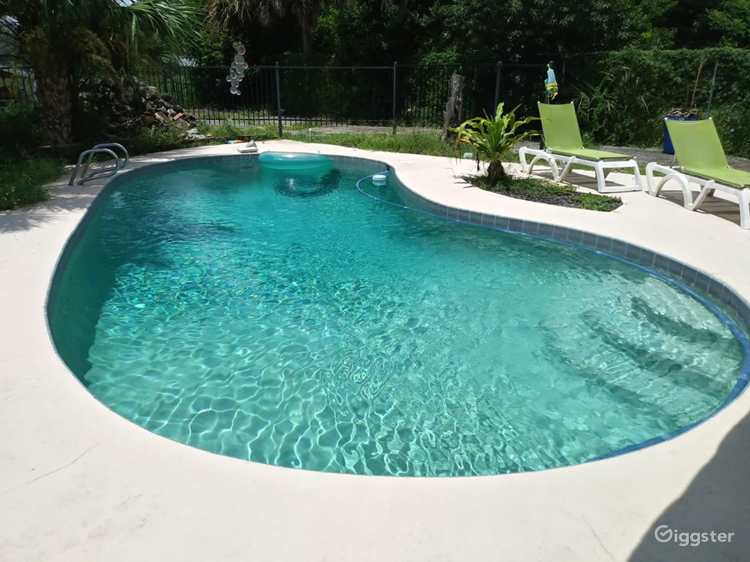 Roomy backyard with a sparkling pool Photo 1
