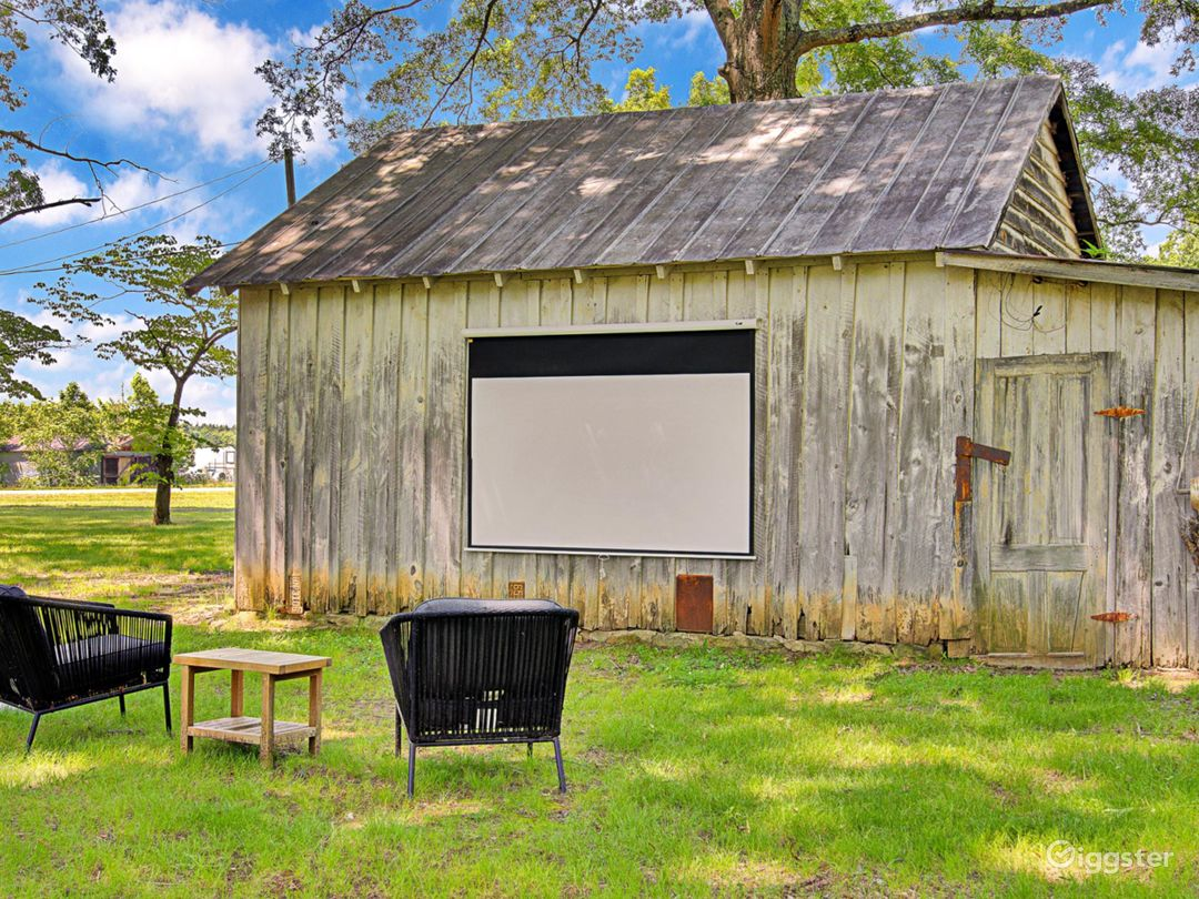 """Outdoor courtyard with 100"""" projector screen"""