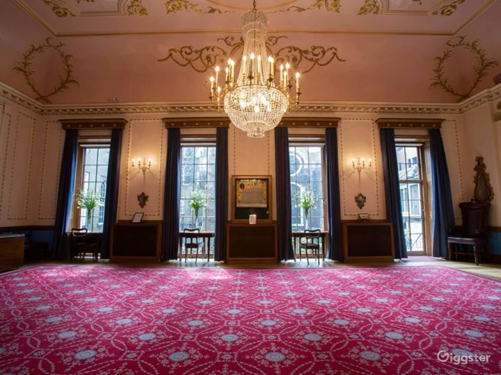 Ornate Room with Chandelier, stain-glassed window and warm carpeting overlooking the garden