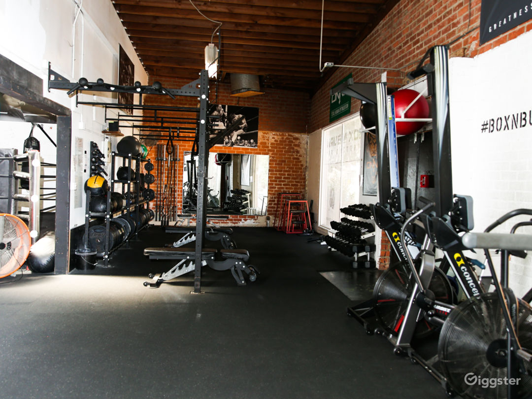 Full weight room with squat racks, cardio equipment, and more.