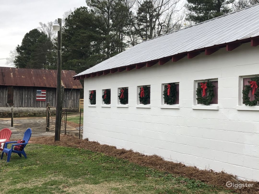 Side view of the original dairy barn at Christmas.