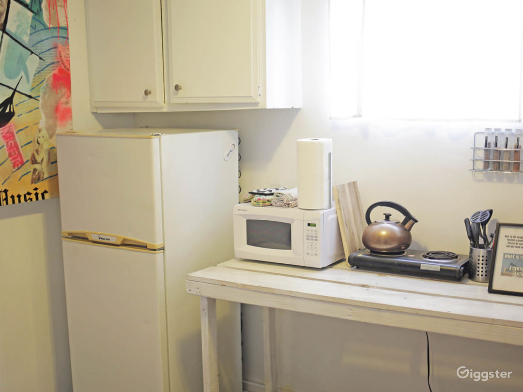 Kitchenette with microwave, coffee maker, hotplate, and refrigerator (**note there is no sink in the kitchen due to the building code, but there is a sink in the bathroom)