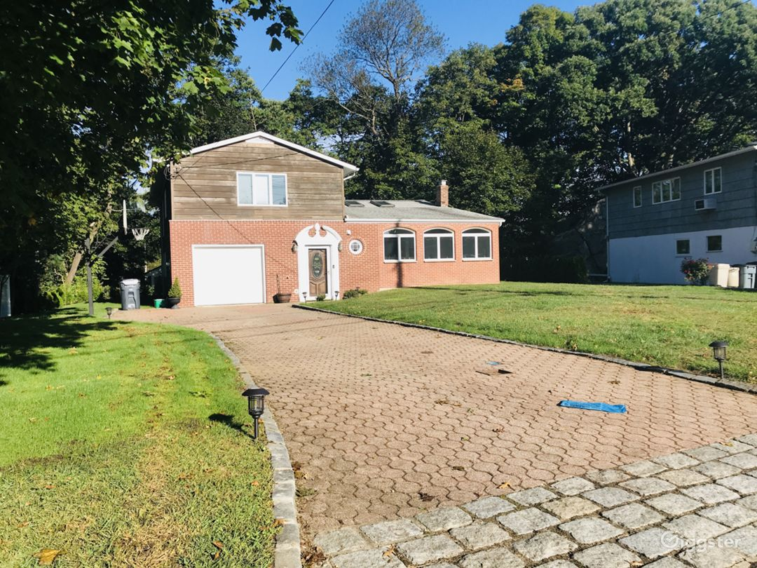 Front of the house. Long Driveway leading to a one car garage. You can comfortably park 5 vehicles in the property. (One inside garage)