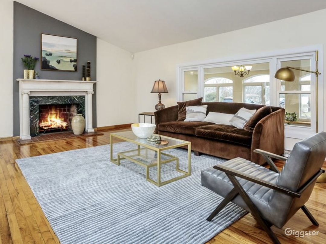 Living room staged. High ceiling and skylights provide for natural light.