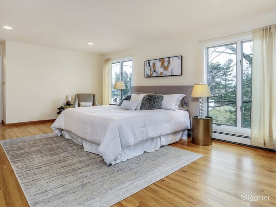 Bright and large master bedroom. With floor to ceiling windows overlooking.