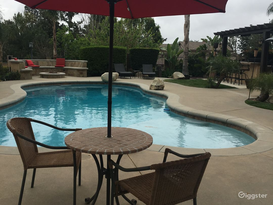 Beautiful backyard with pool, fire out, large outdoor kitchen