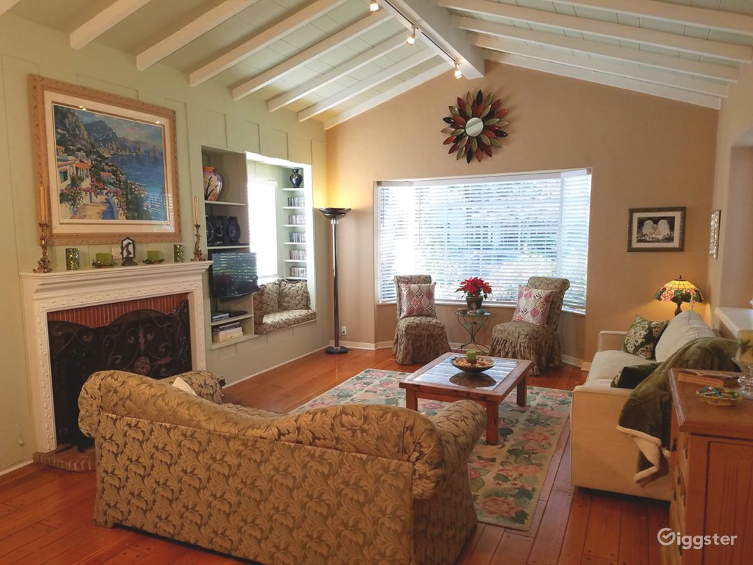 The living room is spacious with vaulted ceilings.
