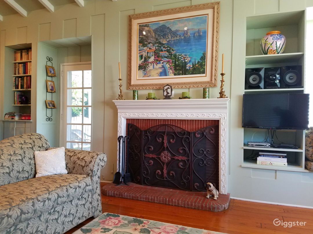 The wood burning fireplace is the focal point of the living room.