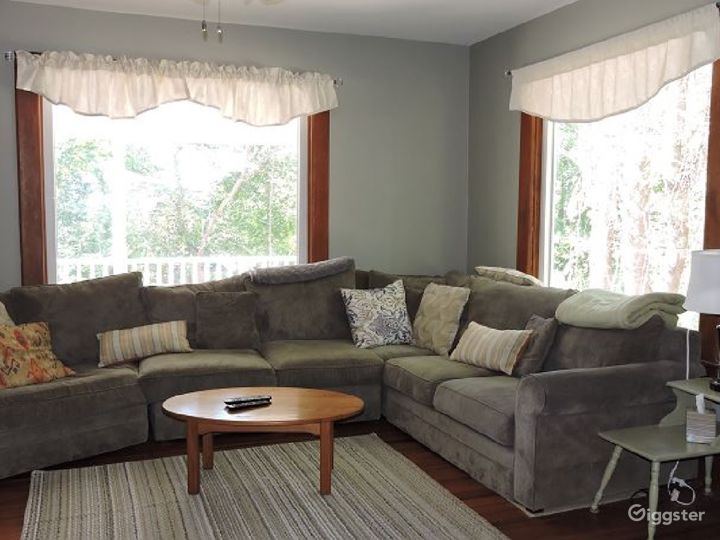 A bright front living room with wrap around couch offers lots of room. There are 2 cable TVs (one in each of the living rooms) as well as wi-fi.