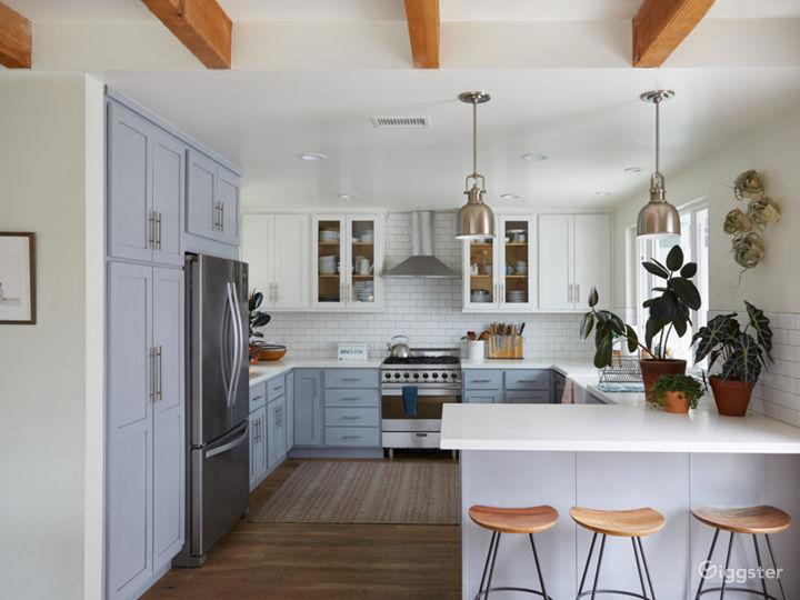 Artist's home, light filled, blue-grey kitchen