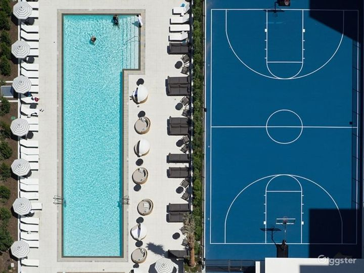 Downtown Rooftop Pool Deck with Basketball Court Photo 3