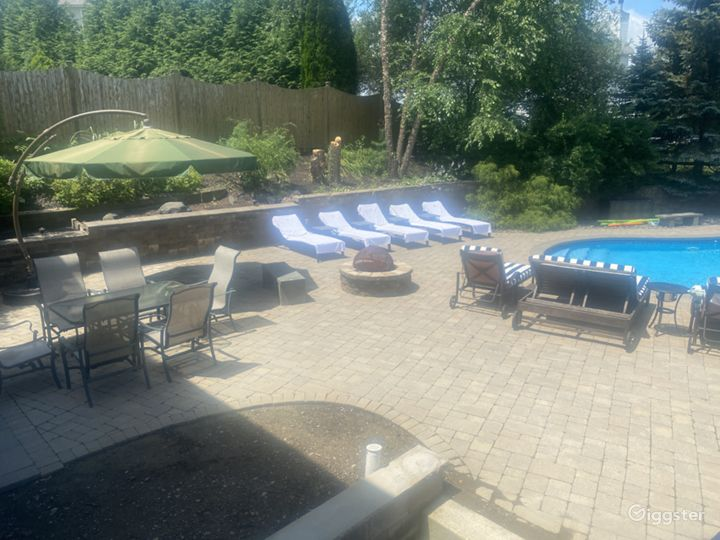 different view of the pool patio with fire-pit