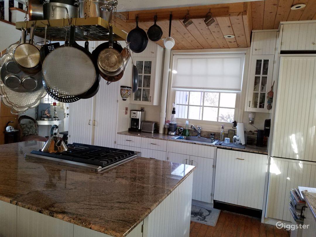 Full gourmet kitchen, granite counters, designer appliances, open floor plan
