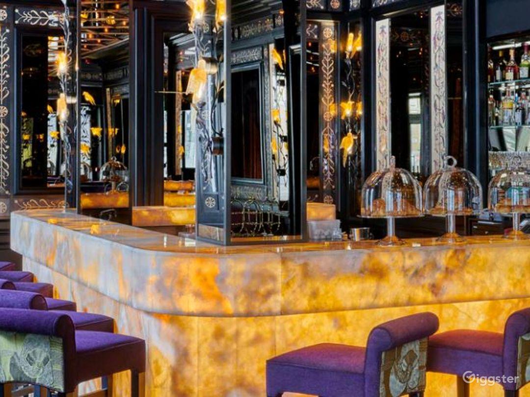 Sophisticated Restaurant with Illuminated Onyx Bar Photo 1