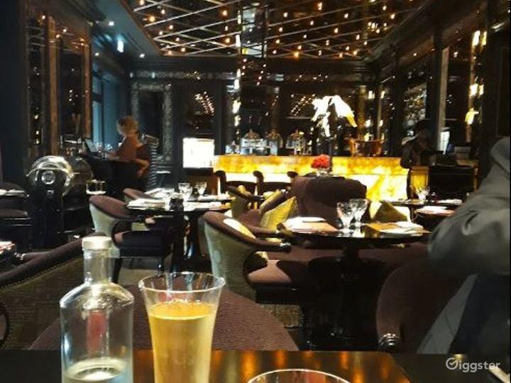 Sophisticated Restaurant with Illuminated Onyx Bar Photo 3