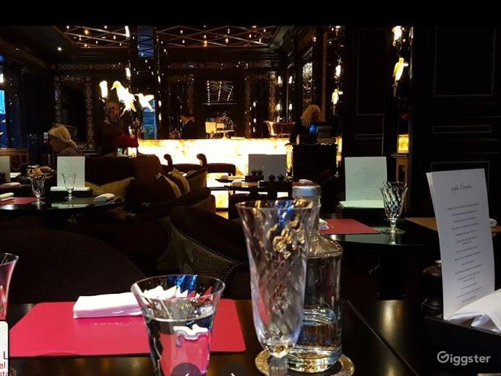 Sophisticated Restaurant with Illuminated Onyx Bar Photo 2