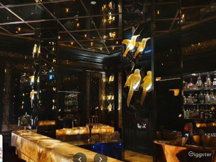 Sophisticated Restaurant with Illuminated Onyx Bar Photo 4