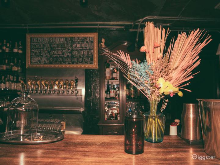 Exotic florals, moody atmosphere, dim lighting, craft beer, gold tap handles