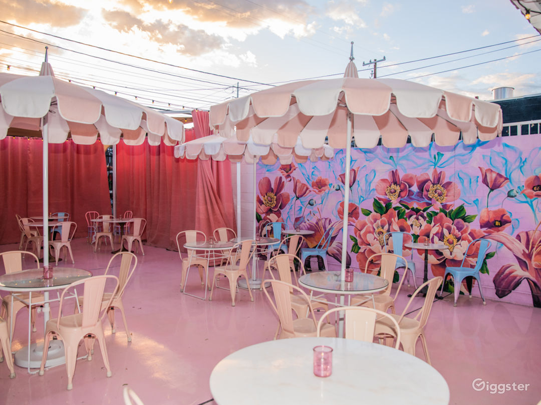 """In the back of the bar is a pastel oasis, dubbed the """"Pink Palace Patio."""""""