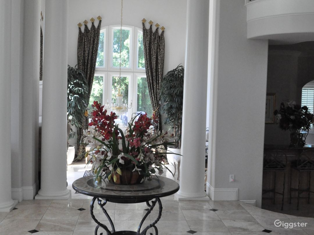 The foyer of the home which is open to the dining room, bar and living room. Its all connected