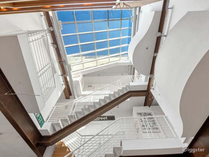Looking up from the living room at the large glass atrium ceiling.