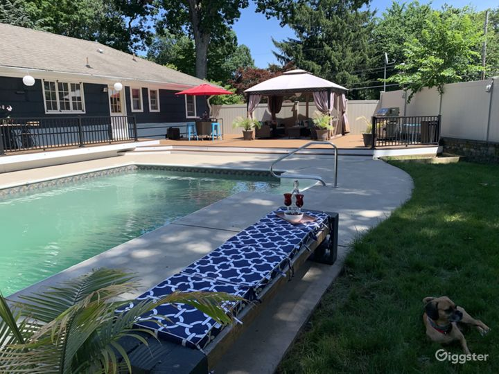 Bench view of pool and gazebo