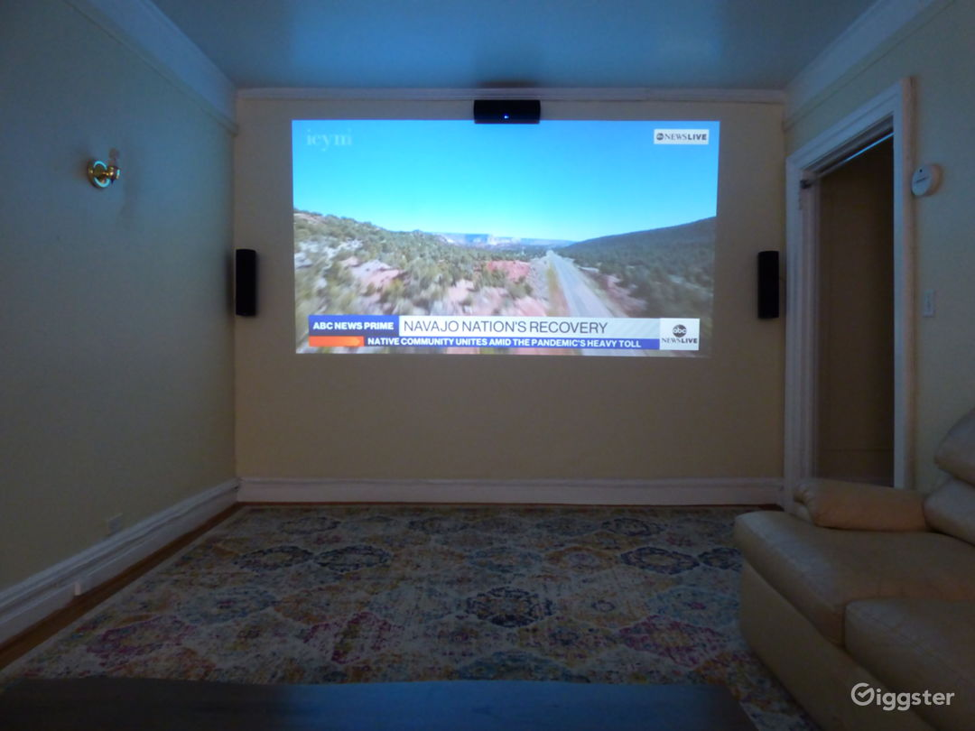 Living Room has surround sound home theater with HD projector.