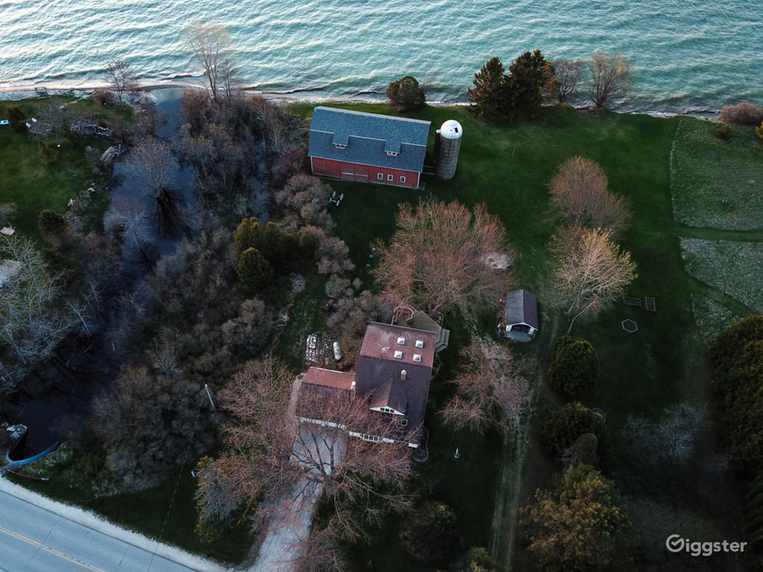 House, shed, barn, silo on 5 acres on Lake Michigan.  An additional 66 acres of woods and fields across the road