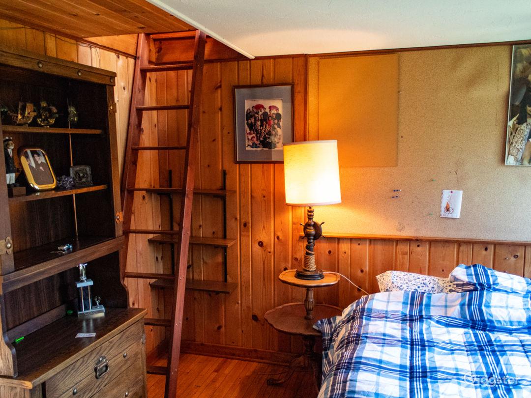 Bedroom with upper loft