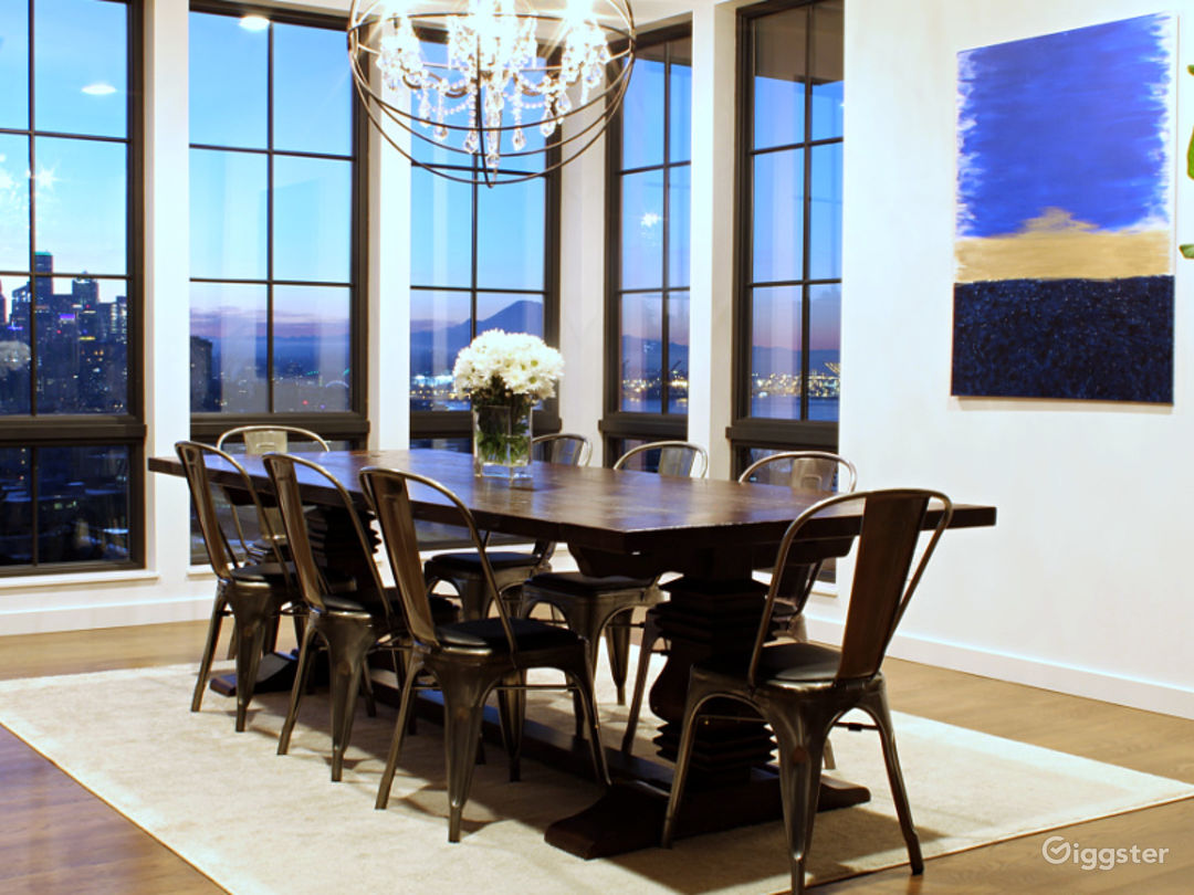 Floor-to-ceiling windows upstairs with high ceilings, table can accommodate up to 12 place settings